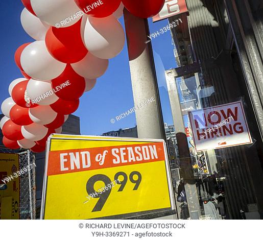 """A clothing store in the Noho neighborhood of New York informs potential employees that it is hiring, as well as having an """"""""End of Season"""""""" sale"""
