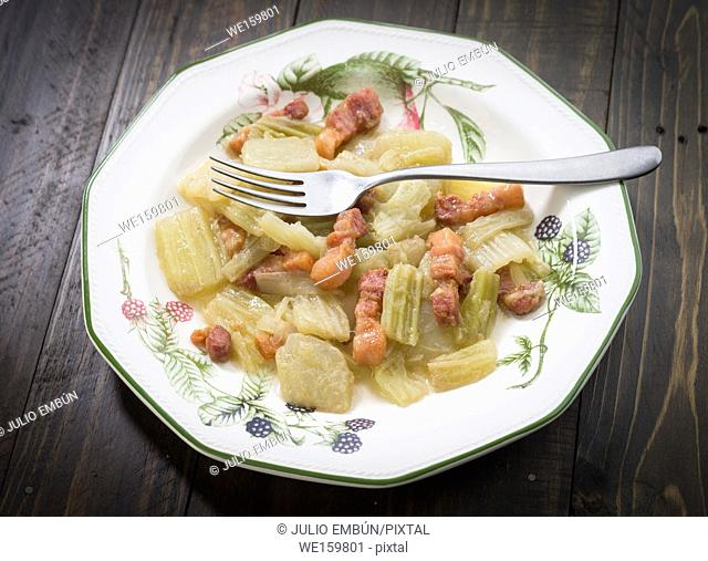 thistle traditional cooked with pancetta on porcelain plate
