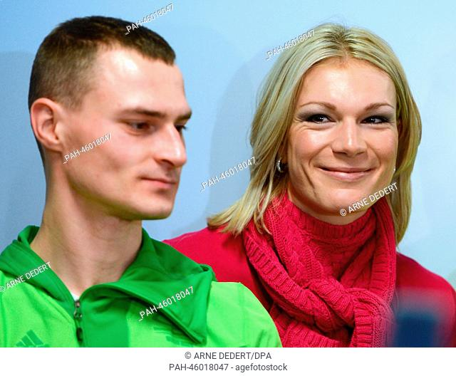 German alpine ski racer Maria Hoefl-Riesch smiles next to short-track speed-skater Robert Seifert before their departure to Sochi at Frankfurt Airport in...