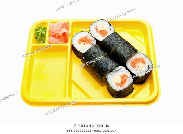 Yellow plate with rolls of sushi