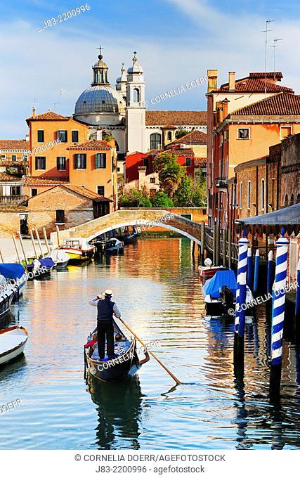 Gondolier on Rio Ognissanti and Church of San Trovaso, Venice, Veneto, Italy, Europe