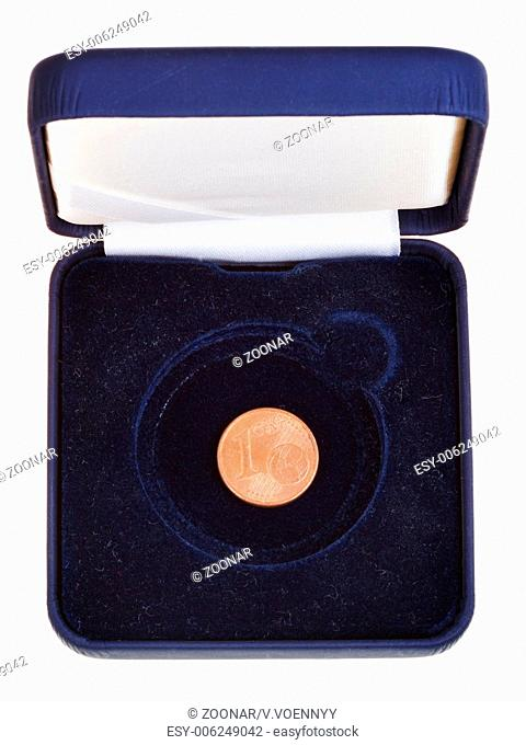 one euro cent in open black box
