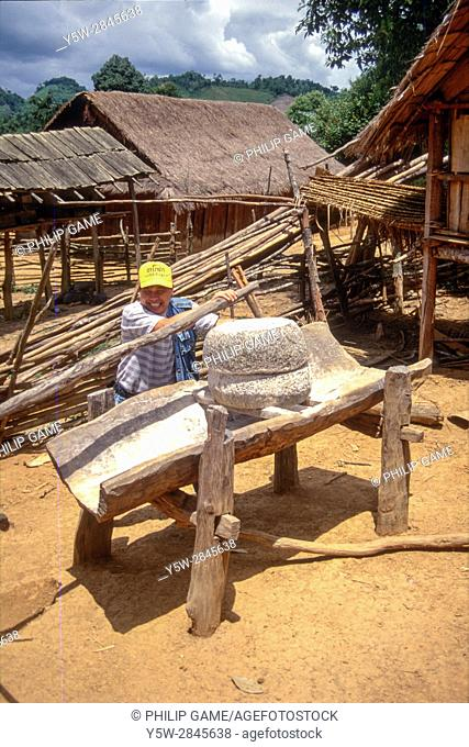 War-time mortar used to husk rice in a Hmong village on the Plain of Jars, Xieng Khouang Province, Laos