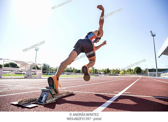 Runner on tartan track starting