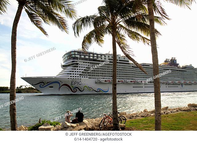Florida, Miami Beach, South Pointe Park, Government Cut, Port of Miami, departing cruise ship, Norwegian Epic, NCL, couple watching, bicycles