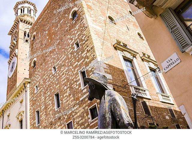 The poet, sculpture of Berto Barbarani, looks at the Lamberti Tower. Piazza delle Erbe. Verona, Veneto, Italy, Europe