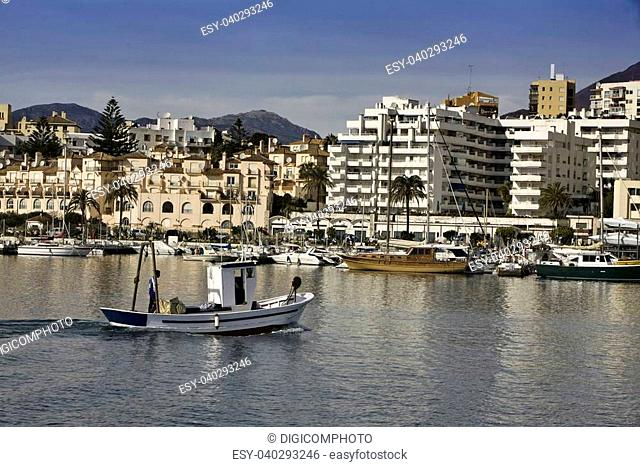 Fishing boat entering the port of Estepona, malaga province, Spain