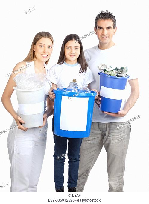 Portrait of happy couple smiling with daughter holding recycle bin