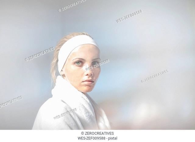 Young woman wearing bathrobe at spa