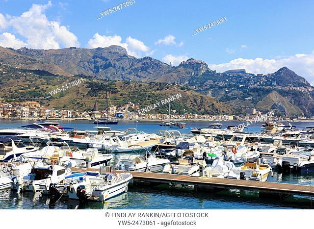 View from Giardini Naxos beach towards Taormina and Castlemola villages on Cape Taormina, Sicily, Italy