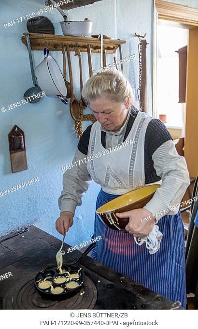Veronika Rehhagen prepares food at the historical farm kitchen of the Advent market 'Wintersonnenwerke'(lit. 'Winter Sun Works')in the open air museum...