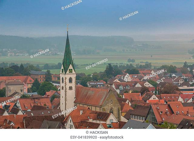 Bird's-eye view from a little village in the country with church