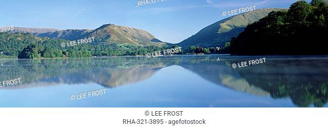 Perfect reflection in early morning, Grasmere, near Ambleside, Lake District, Cumbria, England, United Kingdom, Europe