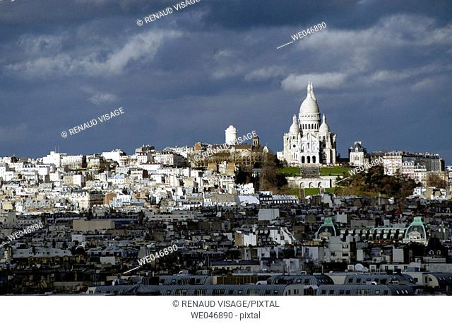 View of Paris rooftops with Sacré Coeur Church in the background. Paris. France
