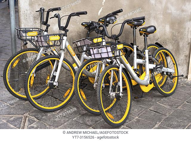 Bikes for hire from Rome's dockless oBike scheme. Rome. Lazio. Italy