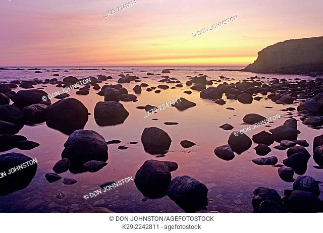 Evening light on rocks at Green Pt . at low tide, Gros Morne NP, NL, Canada