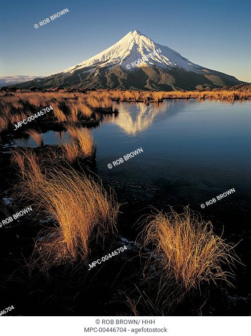 Mount Taranaki reflected in pond on Pouakai Range, New Zealand
