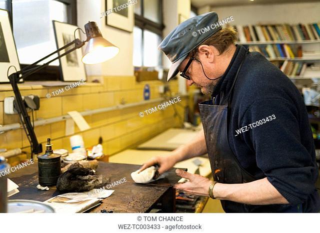Germany, Bavaria, Mature man working in print shop