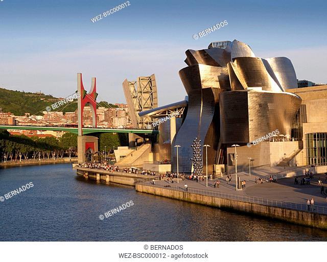 Spain, Basque country, Bilbao, View of Guggenheim Museum Bilbao with bridge in background