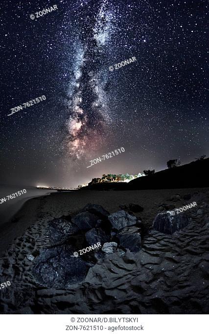 Milky Way. Beautiful summer night sky on the beach in Ukraine. T