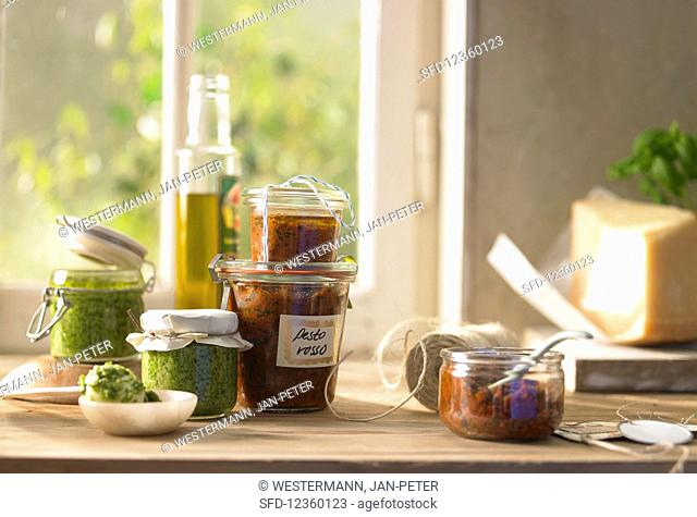 Pesto rosso and rocket pesto in glass jars