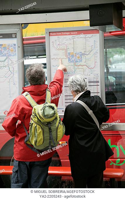 Senior Tourists Pointing out Bus Journey - London UK