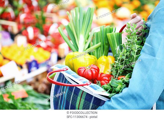 Fresh vegetables in a checked shopping bag