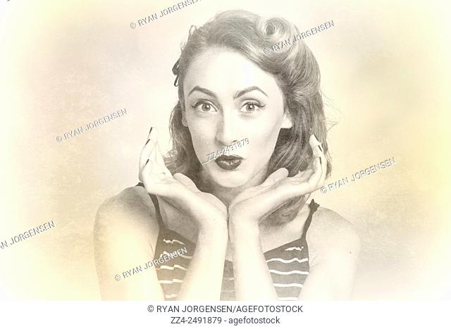 Classical old photo of a cute and quirky pin up girl with look of surprise in old French rolls hair style. Vintage hair pin up