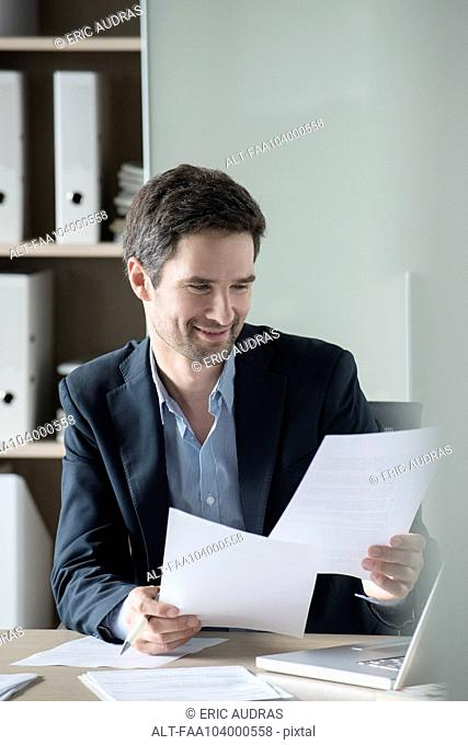 Businessman reviewing paperwork