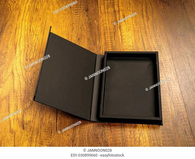 Blank black box mock up on wood background