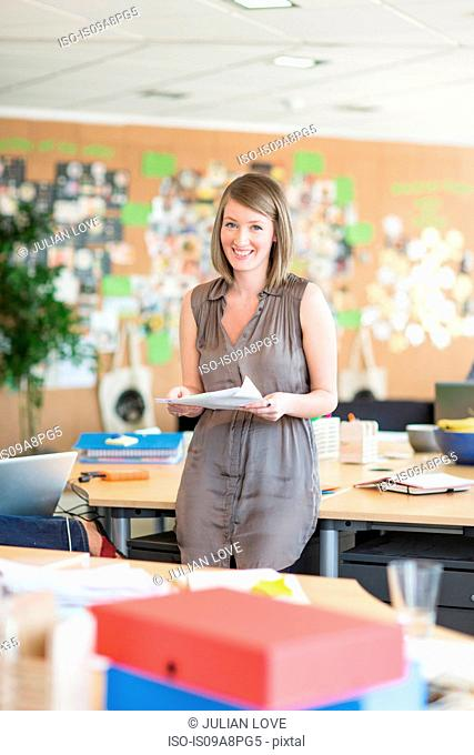 Young woman in creative office