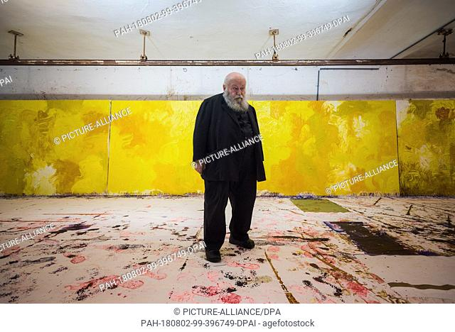 01 August 2018, Austria, Prinzendorf an der Zaya: The Austrian painter and action artist Hermann Nitsch in front of some of his yellow works in the studio at...