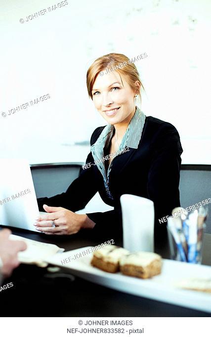 Businesswoman at her desk, Sweden