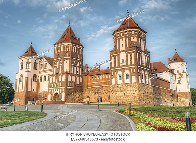 Mir, Belarus. Mir Castle Complex On Blue Sunny Sunset Sky Background. Architectural Ensemble Of Feudalism, Cultural Monument, UNESCO Heritage