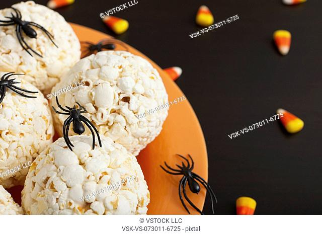 Toy spiders crawling on popcorn balls