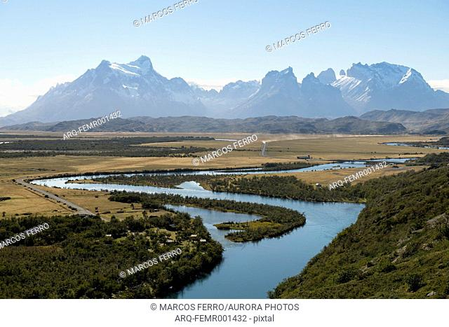 Majestic natural scenery with Rio Serrano river and mountain range in Torres del Paine National Park, Magallanes Region, Chile