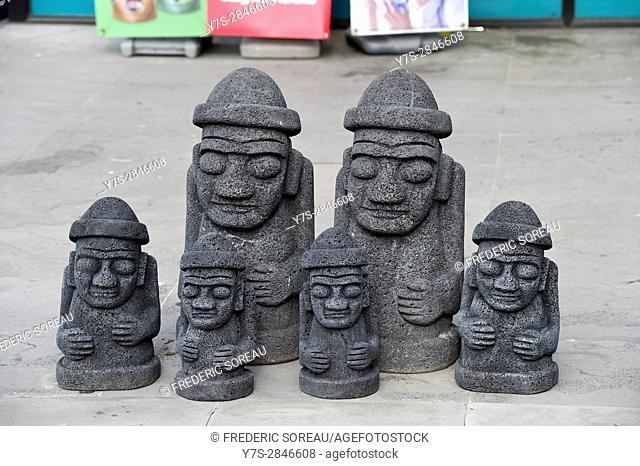 Stone statue of Harubang, national landmark symbol of Jeju island in South Korea