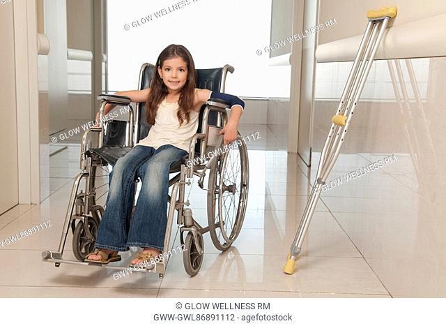 Girl sitting in a wheelchair
