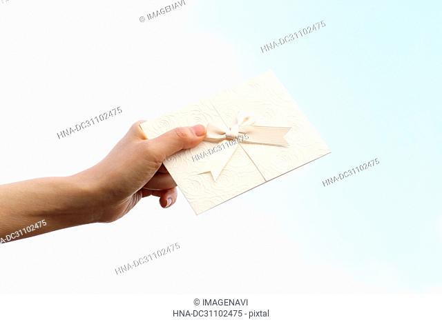Woman Hand Holding Invitation Card
