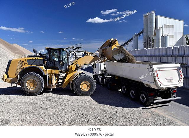 Wheel loader loading gravel on truck
