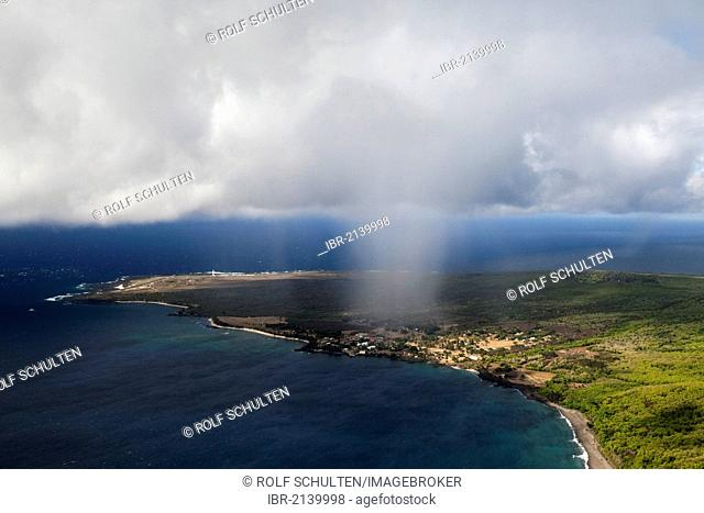 Trade winds carrying rain clouds over the Kalaupapa Peninsula, a former leper colony on the northern coast of the island of Moloka'i