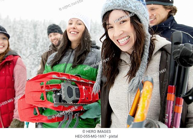 friends preparing to snowshoe