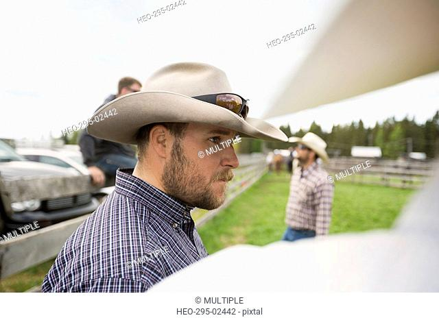 Cattle rancher in cowboy hat looking away
