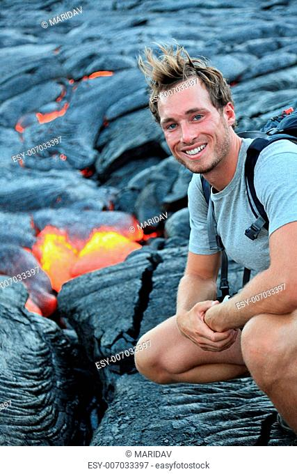 Hawaii: Hiker seeing lava from Kilauea volcano around Hawaii volcanoes national park, USA. Young caucasian man hiking