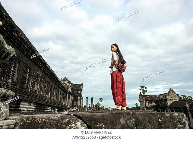 Female tourist at Angkor Wat, City of Temples; Siem Reap, Cambodia