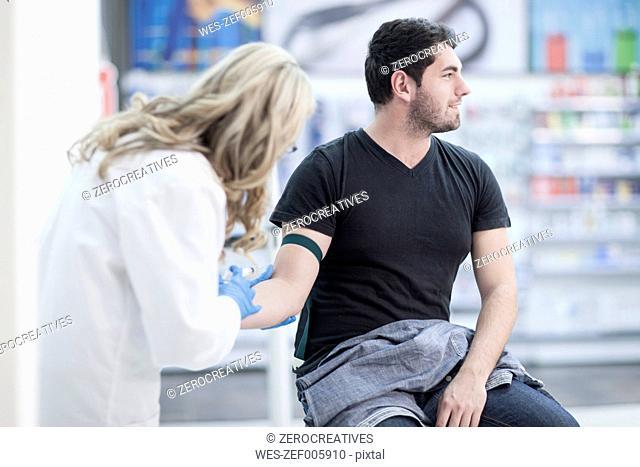 Doctor taking blood sample