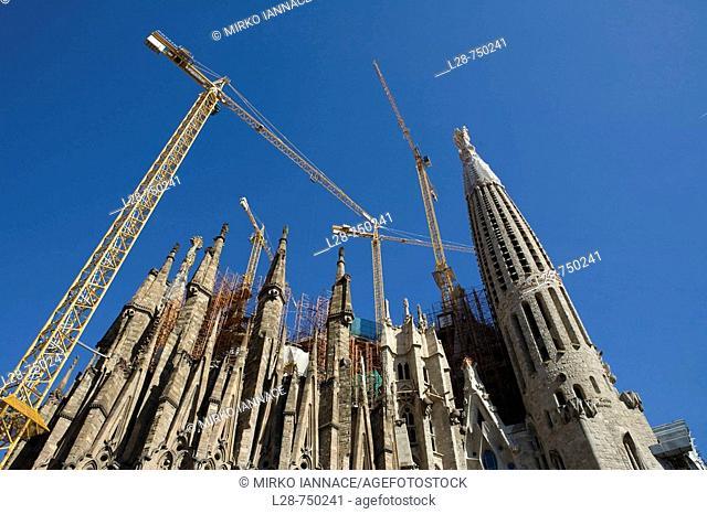 Wide view of the Sagrada Familia with cranes. Barcelona, Catalonia, Spain