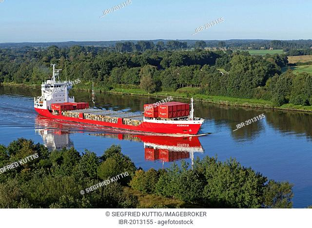 Container ship on the Kiel Canal near Schafstedt, Schleswig-Holstein, Germany, Europe