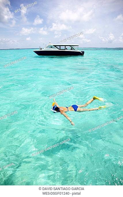 Maldives, Maafushi island, woman snorkeling