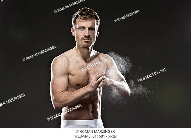 Portrait of muscular shirtless man ready for fighting